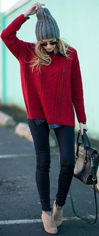Team a red cable knit sweater with navy slim jeans to bring out the stylish in you. Go for a pair of beige suede booties to va-va-voom your outfit.