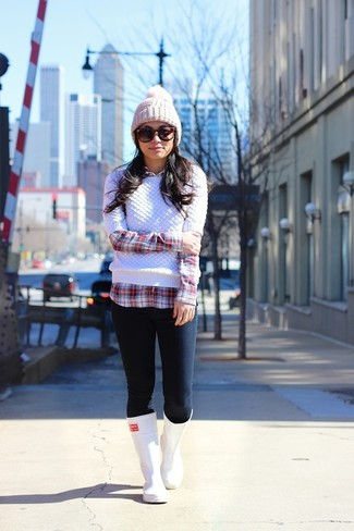 If you're a fan of comfort dressing when it comes to your personal style, you'll love this cute combination of a white cable sweater and a Free People women's Back To Basic Chunky Rib Beanie. Grab a pair of white rain boots for a more relaxed vibe. This is a fail-safe option for an easy-to-transition look.
