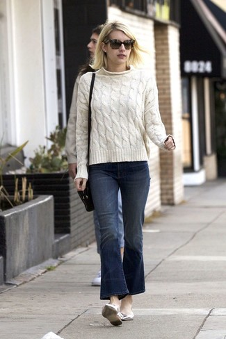 How to Wear Navy Flare Jeans: A white cable sweater and navy flare jeans will add extra style to your day-to-day casual lineup. If you're clueless about how to finish off, introduce silver leather ballerina shoes to this getup.