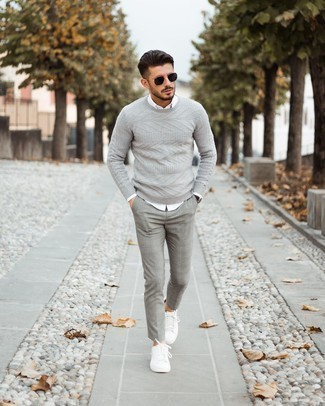White Long Sleeve Shirt Outfits For Men: A white long sleeve shirt and grey plaid chinos are the perfect foundation for a ton of combinations. If you're puzzled as to how to round off, a pair of white leather low top sneakers is a savvy option.
