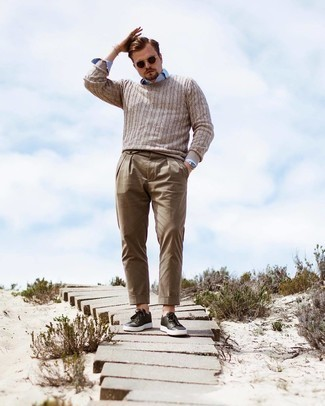 Light Blue Long Sleeve Shirt Outfits For Men: This look with a light blue long sleeve shirt and brown chinos isn't hard to score and is easy to adapt according to circumstances. A trendy pair of dark green leather low top sneakers is the simplest way to give a hint of stylish casualness to your outfit.