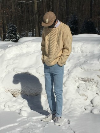 Light Blue Jeans Outfits For Men: Pair a beige cable sweater with light blue jeans to create a casually cool ensemble. Complement your look with grey canvas low top sneakers and the whole look will come together.