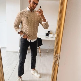 Black Jeans Spring Outfits For Men: This combo of a tan cable sweater and black jeans is an interesting balance between fun and dapper. When it comes to shoes, complete your look with a pair of white canvas low top sneakers. Longer daylight hours call for lighter outfits like this one.