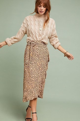 How to Wear a Tan Leopard Midi Skirt: This combo of a beige cable sweater and a tan leopard midi skirt will allow you to show your styling skills even on weekend days. For something more on the dressier side to complete this outfit, introduce black leather heeled sandals to the equation.