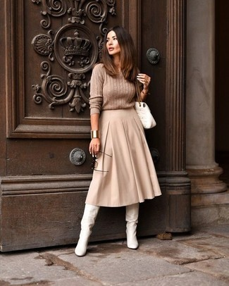 Gold Bracelet Outfits: If you like off-duty combinations, then you'll appreciate this combination of a tan cable sweater and a gold bracelet. Make this ensemble slightly more refined by rounding off with a pair of white leather knee high boots.