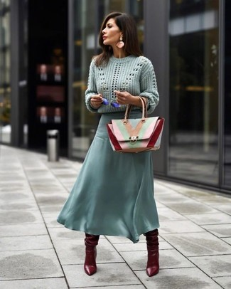 How to Wear Pink Earrings: If you're a fan of casual looks, why not test drive this combination of a mint cable sweater and pink earrings? Burgundy leather knee high boots are a simple way to transform your ensemble.