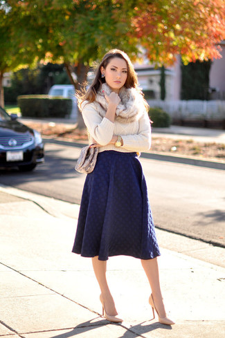 How to wear: beige cable sweater, navy pleated midi skirt, tan leather pumps, brown snake leather crossbody bag