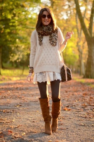 This pairing of a beige cable sweater and a brown leopard scarf gives off a very casual and approachable vibe. Rock a pair of brown suede knee high boots to va-va-voom your outfit. An amazing example of transeasonal style, this getup is an essential this spring.