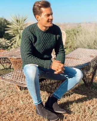 Black Suede Chelsea Boots Outfits For Men: For a relaxed ensemble, go for a dark green cable sweater and light blue ripped skinny jeans — these pieces work perfectly well together. Avoid looking too casual by finishing off with black suede chelsea boots.