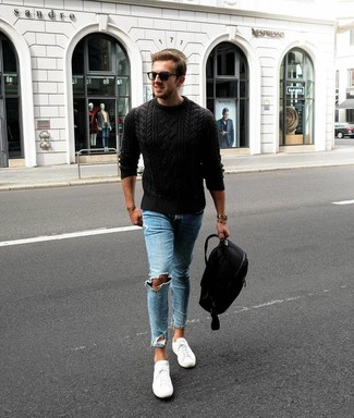 How to wear: black cable sweater, light blue ripped skinny jeans, white low top sneakers, black backpack
