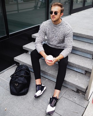How to wear: grey cable sweater, black sweatpants, black and white athletic shoes, black leather holdall