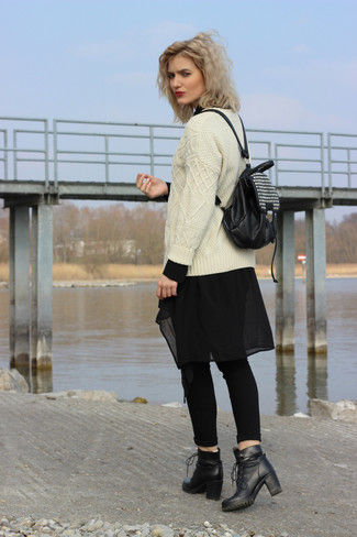 How to wear: beige cable sweater, black chiffon tunic, black skinny jeans, black leather lace-up ankle boots