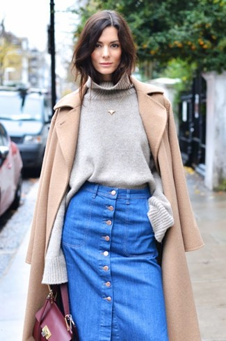 Let everyone know that you know a thing or two about style in a tan coat and a blue denim button skirt.