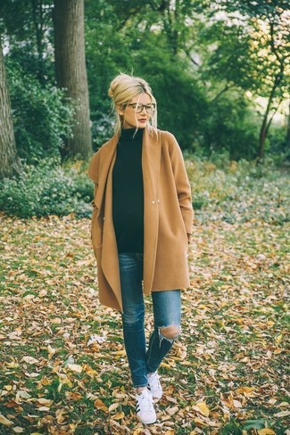 Stand out among other stylish civilians in a tan coat and blue distressed slim jeans. White and black low top sneakers are the right shoes here to get you noticed.