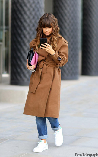 Miroslava Duma wearing Camel Coat, Blue Boyfriend Jeans, White and Green Low Top Sneakers, Black Leather Clutch