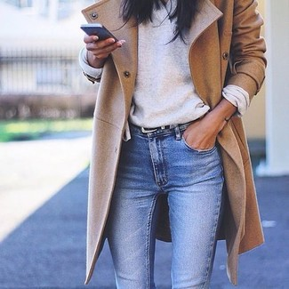 Step up your off-duty look in a camel coat and blue skinny jeans. Rest assured, this look will keep you snug as well as looking beyond chic in this transeasonal weather.