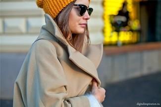 How to wear: camel coat, white crew-neck sweater, mustard beanie
