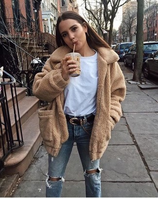 How to Wear Light Blue Ripped Jeans For Women: For a look that's pared-down but can be manipulated in a ton of different ways, opt for a camel fleece coat and light blue ripped jeans.