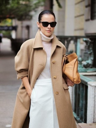 Tap into refined, elegant style with a camel coat and a white pencil skirt.