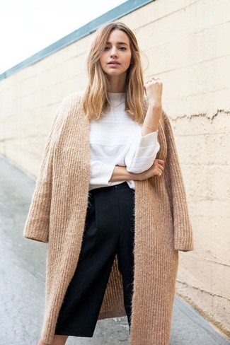 How to wear: camel knit coat, white crew-neck sweater, black culottes