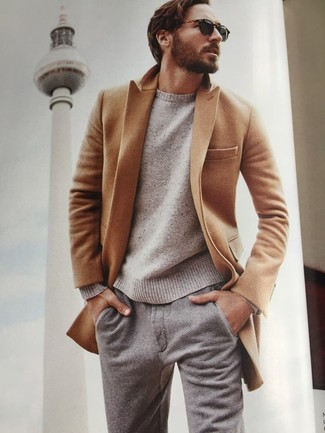 How to wear: camel overcoat, beige crew-neck sweater, grey wool chinos