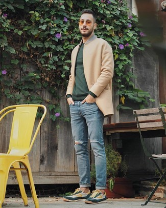 How to wear: camel overcoat, dark green crew-neck sweater, light blue ripped jeans, dark green low top sneakers