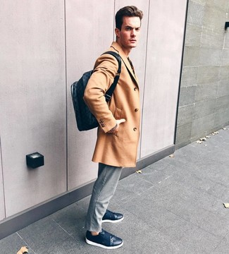 How to wear: camel overcoat, grey vertical striped chinos, navy leather low top sneakers, navy leather backpack