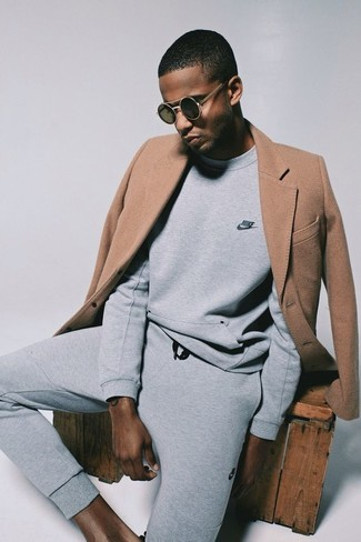 How to wear: camel overcoat, grey sweatshirt, grey sweatpants, black sunglasses