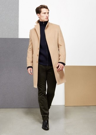 How to wear: camel overcoat, navy zip sweater, olive corduroy jeans, black leather chelsea boots