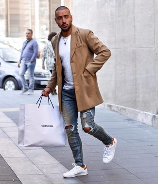 How to wear: camel overcoat, white crew-neck t-shirt, blue ripped skinny jeans, white leather low top sneakers