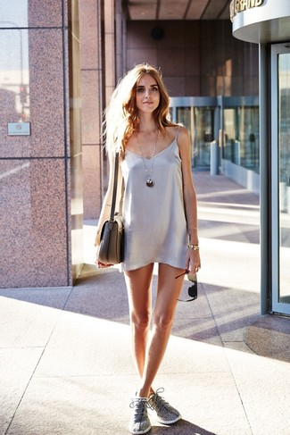 Go for a silver satin cami dress and a silver pendant to achieve a chic look. A pair of grey athletic shoes ads edginess to a femme classic. This one is just perfect if you're trying to pick out an outfit worth 'gramming.