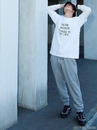 876699afd895 Look de moda: Camiseta de manga larga estampada en blanco y negro ...