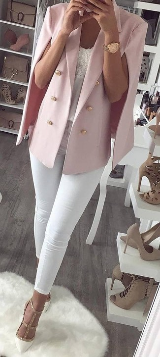 How to Wear a Hot Pink Cape Blazer: You'll be amazed at how super easy it is to get dressed this way. Just a hot pink cape blazer and white skinny jeans. Clueless about how to round off? Complete this outfit with a pair of white studded leather pumps to bump up the style factor.