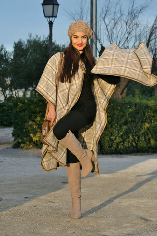 Opt for a cream plaid cape coat and black leggings to effortlessly deal with whatever this day throws at you. A cool pair of beige suede knee high boots is an easy way to upgrade your look.