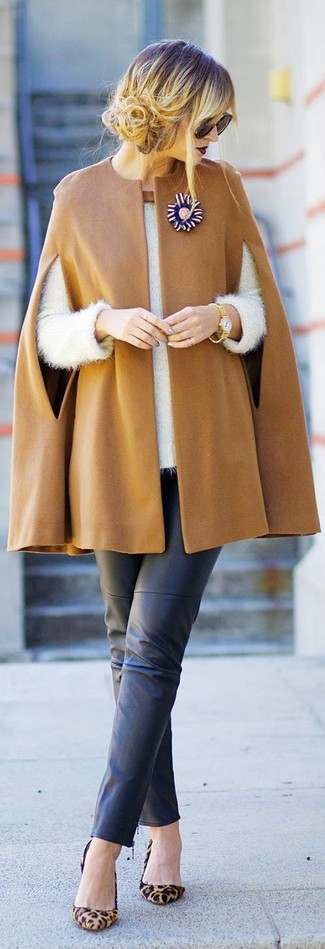 Rock a khaki cape coat with black leather slim trousers for a seriously stylish look. Round off this look with tan leopard suede pumps.
