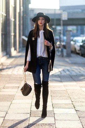 How to wear: black cape coat, white silk dress shirt, navy skinny jeans, black suede over the knee boots
