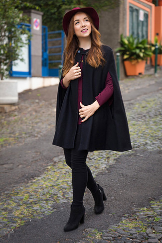 Go for a sophisticated look in a black cape coat and a ring. Complement this look with black suede booties. We promise this combo is the answer to all of your springtime dressing problems.