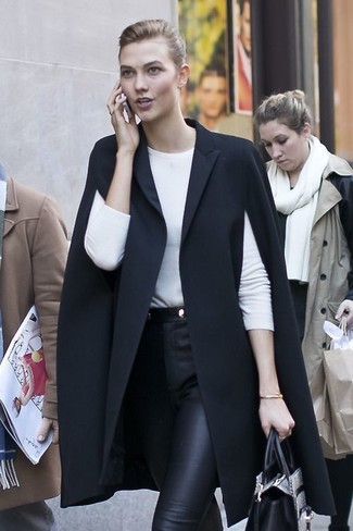 How to wear: black cape coat, white long sleeve t-shirt, black leather skinny pants, grey snake leather tote bag