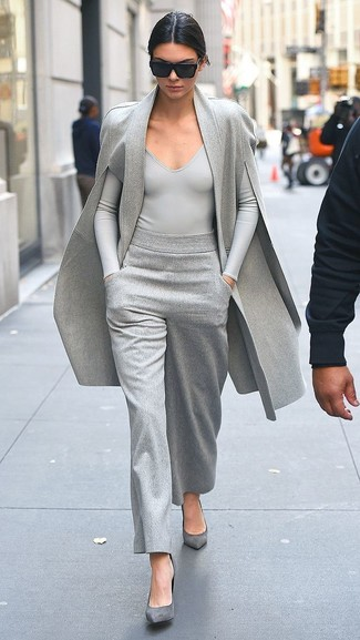 Grey Suede Pumps Outfits: Demonstrate your outfit coordination savvy in this combination of a grey cape coat and grey wide leg pants. Grey suede pumps round off this look quite nicely.