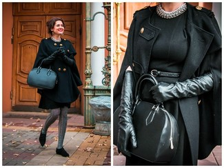 This combination of a black cape coat and a black wool sheath dress oozes refined elegance. Black suede oxfords are a savvy choice to complete the look.
