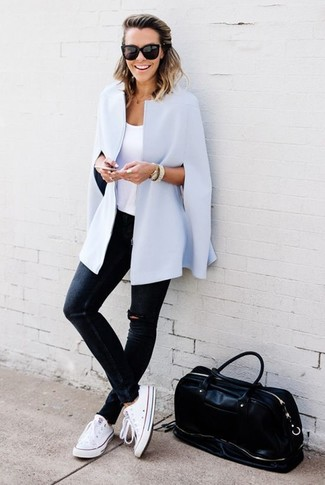 How to wear: light blue cape coat, white tank, navy ripped skinny jeans, white canvas low top sneakers