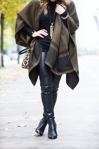 How to wear: olive cape coat, black turtleneck, black leather leggings, black leather over the knee boots