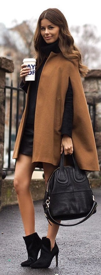 A tan cape coat and a black leather mini skirt is a wonderful combination to carry you throughout the day. Choose a pair of black booties to va-va-voom your outfit.