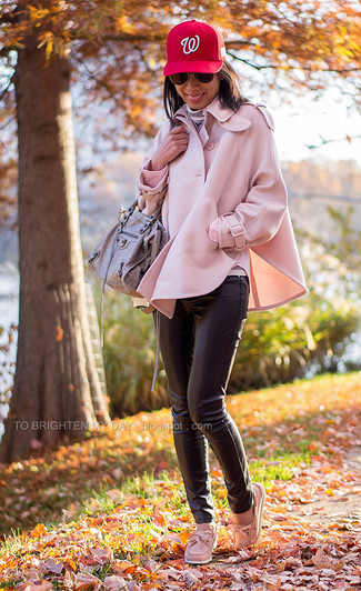 How to wear: pink cape coat, grey horizontal striped turtleneck, black leather skinny pants, pink leather boat shoes