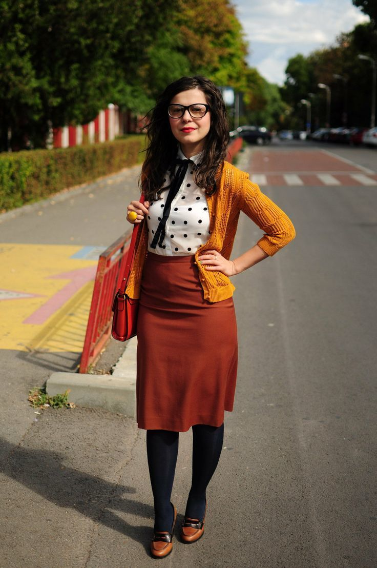 Pairing a mustard cardigan with a tobacco pencil skirt is an on-point  option for