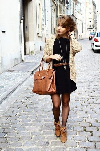A cardigan and a black casual dress is a nice combination to carry you throughout the day. Brown leather ankle boots will add elegance to an otherwise simple look.
