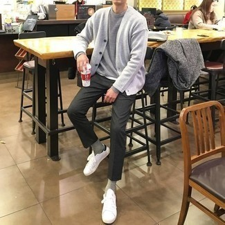 Charcoal Chinos Outfits: Go for a pared down but casually cool choice pairing a grey crew-neck sweater and charcoal chinos. Add a pair of white and black canvas low top sneakers to this ensemble to make a classic outfit feel suddenly edgier.