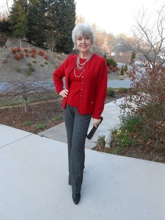 How to wear: red cardigan, red crew-neck sweater, charcoal dress pants, black leather ankle boots
