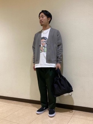 White Print Crew-neck T-shirt Outfits For Men: Choose a white print crew-neck t-shirt and dark green chinos to pull together an everyday outfit that's full of charm and personality. Balance this ensemble with a sleeker kind of footwear, like these black canvas slip-on sneakers.