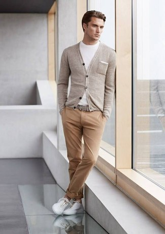 Pairing a grey cardigan with camel chinos is a comfortable option for running errands in the city. Feeling brave? Complete your look with white low top sneakers.